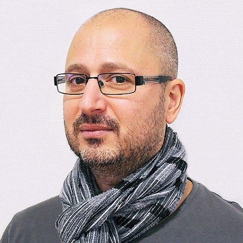 Ansiktsbild på kassasäljare Alexander Papamichailidis.